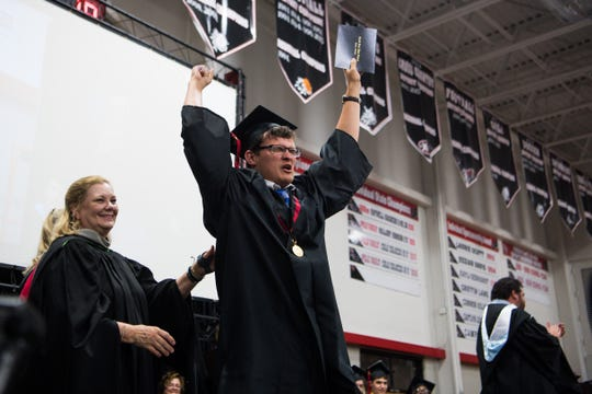 Class of 2019 graduate Kevin Keays celebrates with a shout on stage during South Fork High School's graduation commencement ceremony Tuesday, May 28, 2019, as Martin County School District Superintendent Laurie Gaylord looks on, at South Fork High School in Tropical Farms.