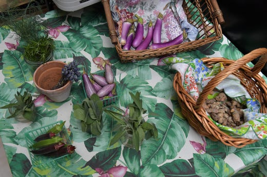 A table with the last of the eggplant, okra, fresh lavender, sage, parsley and dill herbs, and some turmeric, is all that is left for sale on their last day of season on Sunday, May 26, 2019, at Ground Floor Farm, in Stuart.