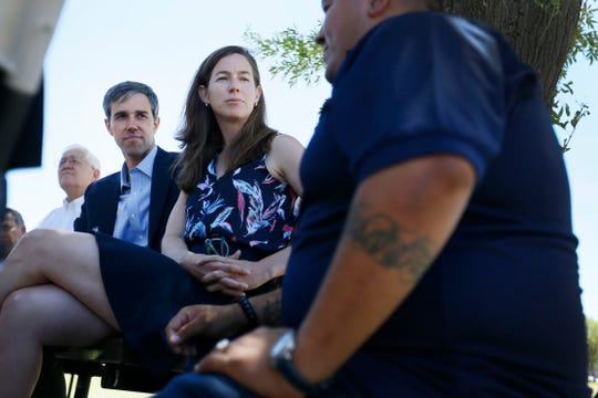 Democratic presidential candidate Beto O'Rourke and his wife Amy O'Rourke listen to Marco Pastrana during a discussion about immigration reform Tuesday, May 28, at Chamizal National Memorial park in El Paso.