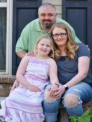 Alexis Dillon, right, with her daughter Livie, 7, and husband Daniel at their home in Piedmont.