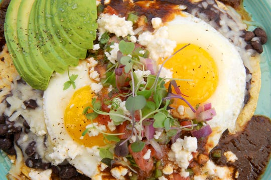 Huevos rancheros are prepared at The Royal Egg Cafe in Westlake Village.
