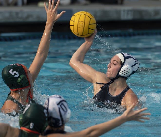 Redwood's Emma Peters shoots against Porterville in a Central Section Division II girls water polo championship on Saturday, November 10, 2018. The Redwood girls water polo squad was one of 15 Rangers teams to win a WYL title during the 2018-19 school year.