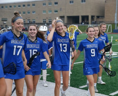 Bronxville players celebrate May 28, 2019 after beating Millbrook in the Class D regional semifinals.