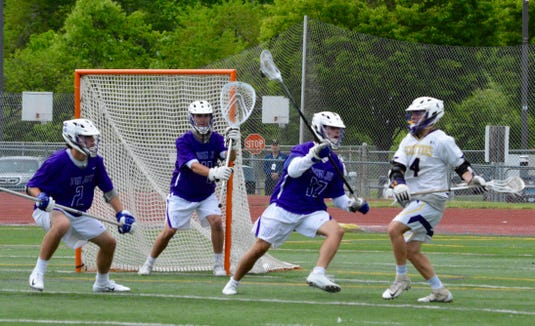 John Jay defender Tommy Feinstein closes in on Ballston Spa attackman Lucas Bennice during the fourth quarter of the Indians regional semifinal win on Wednesday, May 29, 2019 at Columbia High School.