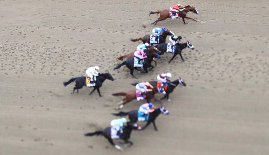 ELMONT, NY - JUNE 09:  (EDITORS NOTE: This image has been taken with a tilt-shift lens) Justify #1, ridden by jockey Mike Smith start with the other horses on his way to winning the 150th running of the Belmont Stakes at Belmont Park on June 9, 2018 in Elmont, New York. Justify becomes the thirteenth Triple Crown winner and the first since American Pharoah in 2015.  (Photo by Al Bello/Getty Images)