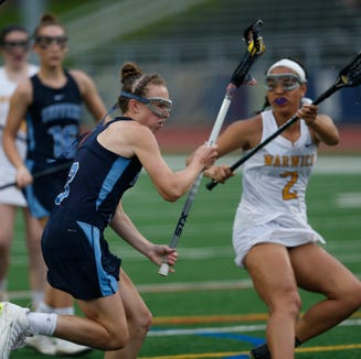 Suffern's Emma Muchnick closes in on Warwick's goal as she's covered by Skylar Blanton during Wednesday's Class B regional semifinal in Newburgh on on May 29, 2019.