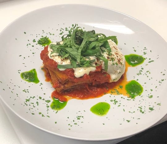 Melenzane Parmigiana, layers of  fried eggplant, fresh mozzarella, marinara sauce with shredded basil and pesto sauce at Novecento Wood Burning Kitchen & Bar in Shrub Oak.