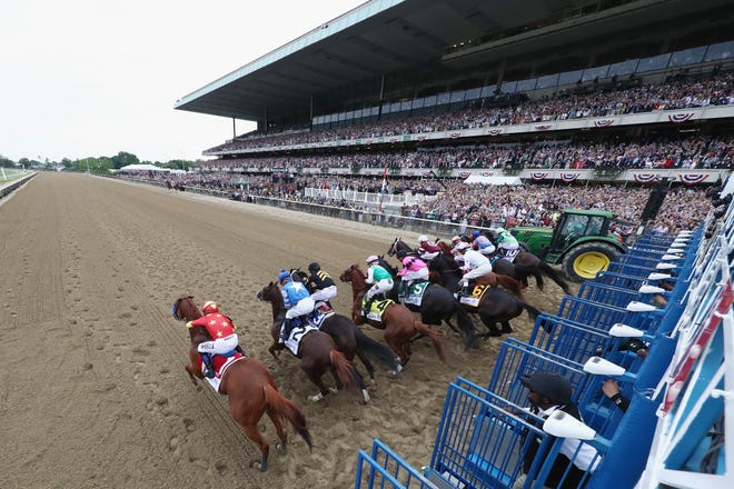 ELMONT, NY - JUNE 09:  Justify #1, ridden by jockey Mike Smith breaks from the gate during the 150th running of the Belmont Stakes at Belmont Park on June 9, 2018 in Elmont, New York. Justify becomes the thirteenth Triple Crown winner and the first since American Pharoah in 2015.  (Photo by Al Bello/Getty Images)