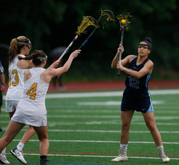 Suffern's Anna Maria Gragani passes the ball away from Warwick's, from left, Maegan Courcy and Stephanie Malota during Wednesday's Class B regional semifinal in Newburgh on on May 29, 2019.