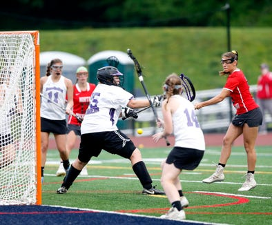 North Rockland's Meg MacMillan takes a shot on Monroe Woodbury's goalie Megan Petko during Tuesday's Class A regional semifinal in Newburgh on on May 28, 2019.