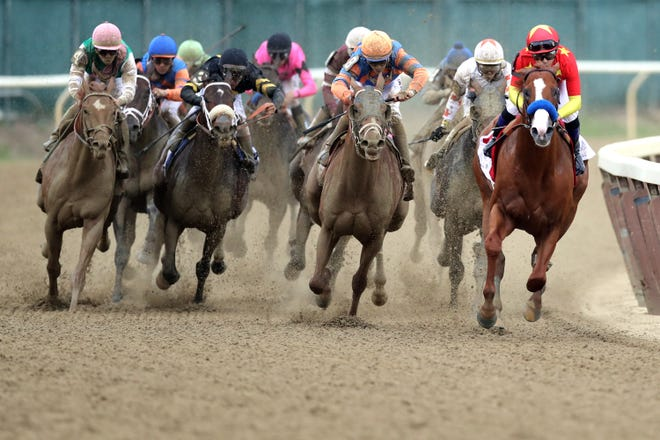 ELMONT, NY - JUNE 09:  Justify #1, ridden by jockey Mike Smith leads the field around the 4th turn during the 150th running of the Belmont Stakes at Belmont Park on June 9, 2018 in Elmont, New York. Justify becomes the thirteenth Triple Crown winner and the first since American Pharoah in 2015.  (Photo by Jim McIsaac/Getty Images)