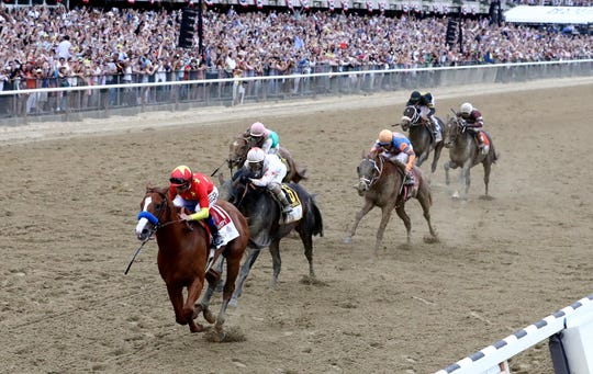 Justify, with jockey Mike Smith aboard, became the 13th Triple Crown winner and second trained by Hall of Famer Bob Baffert in four years, with this win in the 2018 Belmont.