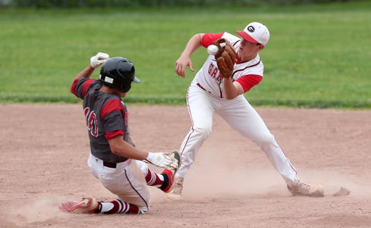 Rye's Mark Surhoff (3) puts the tag on Nyack's Billy Sullivan (10) after he tried to steal second in the first inning during baseball action at Disbrow Park in Rye May 29, 2019.