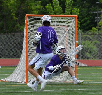 John Jay goalie Jack Browne makes a save in the first half of the Indians' 13-6 regional semifinal win on Wednesday, May 29, 2019 at Columbia High School.