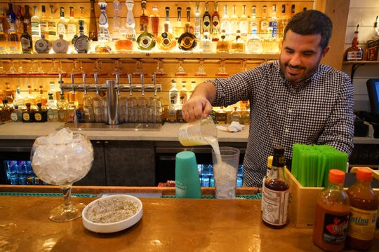 David Hayes, the bar manager at the new BarRoja that just opened at the former home of Scratch Magoo's in Wilmington, prepares a new house drink specialty called the Jorge, a jumbo 53-ounce margarita that cast $46 and is made with Casamigos Reposado tequila, fresh lime, agave syrup with a salt and pepper rim.