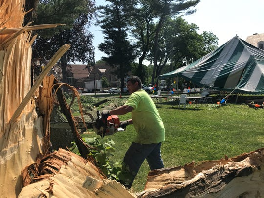 A hard wind snapped a tree limb during the Holy Rosary Catholic Church Carnival in Claymont Tuesday night, which fell on a crowded tent and caused minor injury to members of a band playing the festival.