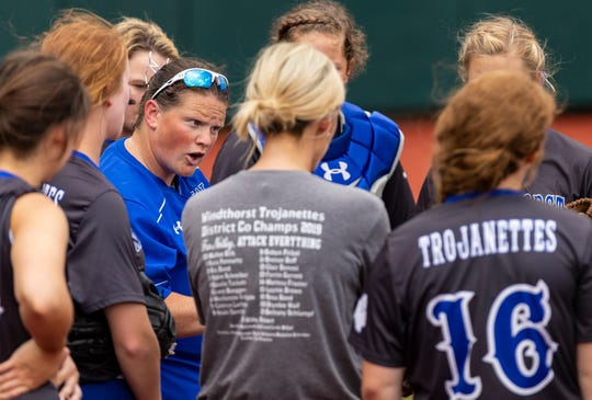 Windthorst head coach Alyson Deatherage speaks to her team between innings during a class 2A UIL softball state semifinal game at McCombs Field, in Austin, Wednesday, May 29, 2019. [Stephen Spillman]