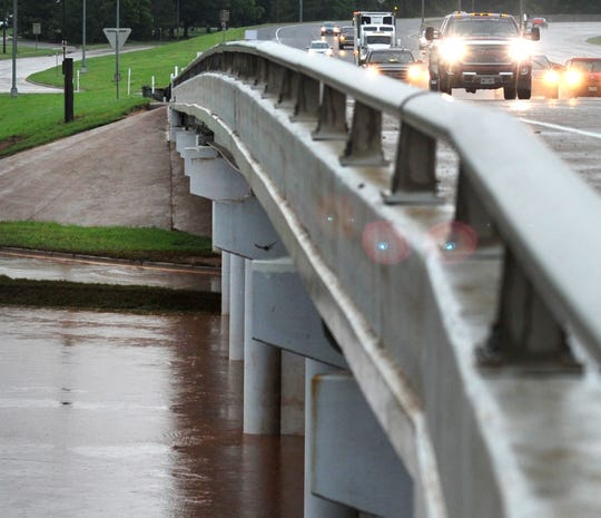 Southbound Central Freeway traffic travels over the rain-swollen Wichita River as the Wichita Falls area continued to receive rainfall Wednesday afternoon.