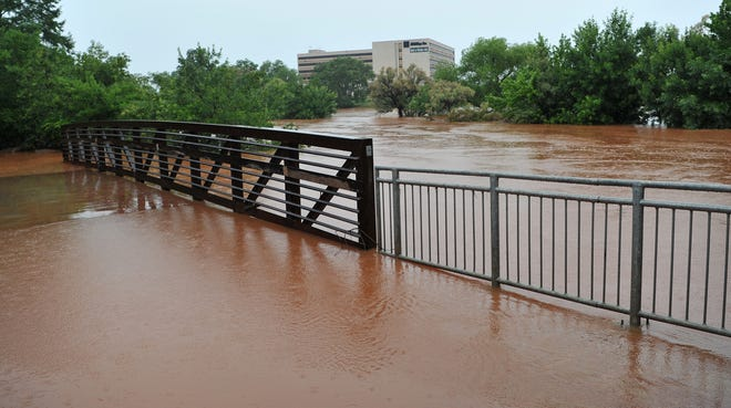 The Wichita River consumed parts of the Lucy Park trail near the Wichita Falls, Tuesday into Wednesday as the area continued to see rain move through the area.