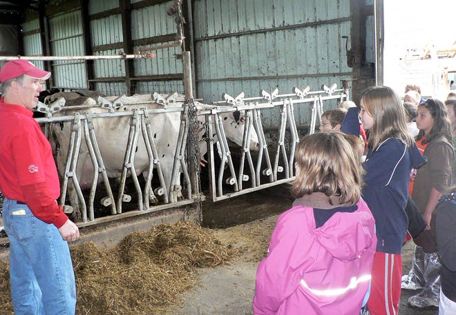 A farmer explains to a group of visitors who the well-being of the animals is addressed on their farming operations. Giving animals the highest quality of life possible should be at the forefront of every sustainable animal farming operation.