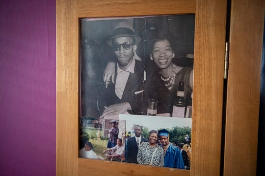 Photos of Charles and Osie Frazier sit on display in a screen in the Frazier family home.