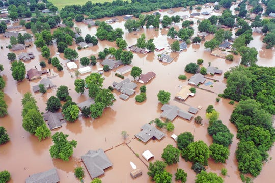This Tuesday, May 28, 2019, aerial photo shows flooded homes along the Arkansas River in Sand Spring, Oklahoma. Communities that have seen little rain are getting hit by historic flooding along the Arkansas River thanks to downpours upstream that have prompted officials to open dams to protect some cities but inundate others with swells of water.