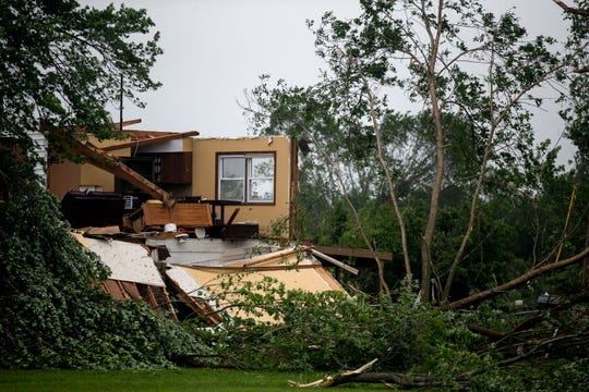 A tornado ripped the walls and roof off a home in rural Lawrence, Kansas, Tuesday evening, part of a string of tornadoes across the Midwest this week.