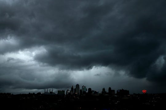 A severe storm that dropped several tornadoes earlier passes behind downtown Kansas City, Mo. on Tuesday, May 28, 2019.