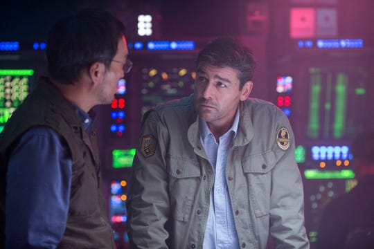 "Mark Russell (Kyle Chandler, right, with Ken Watanabe) desperately wants to get his family back after they're kidnapped in ""Godzilla: King of the Monsters."""