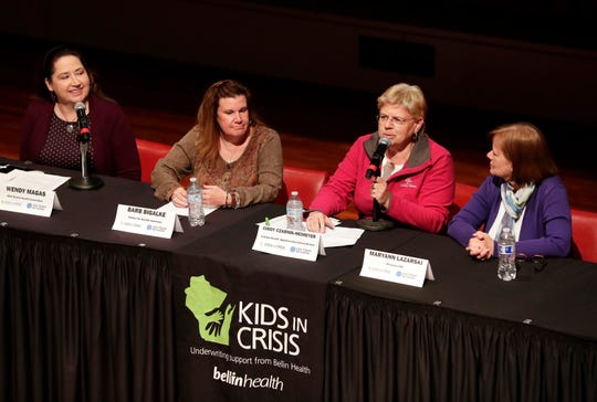 "Four panelists, from left Wendy Magas of N.E.W. Mental Health Connection, Barb Bigalke of Center for Suicide Awareness, Cindy Czarnik-Neimeyer of Catalpa Health and the Appleton Area School District and Maryann Lazarski of Milwaukee PBS, lead a panel discussion after a screening of the documentary ""You're Not Alone"" Wednesday in Appleton."