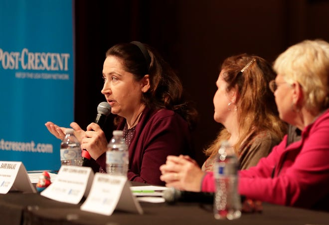 Wendy Magas, with N.E.W. Mental Health Connection, speaks during a panel discussion following a screening of 'You're Not Alone,' a documentary about youth mental health Wednesday in Appleton.