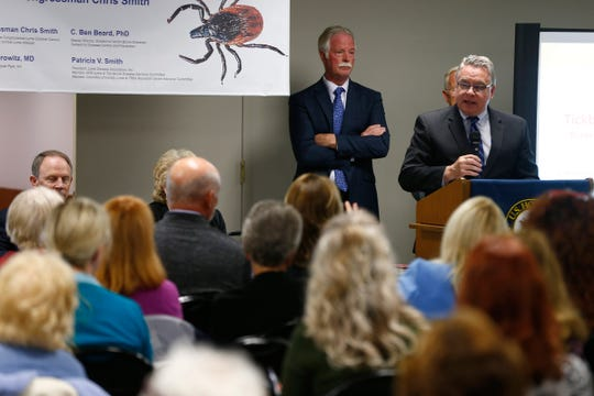 US Congressman Chris Smith (R-NJ) opens a panel discussion about Lyme disease research held at the Wall Township Municipal building Wednesday, May 29, 2019. Behind him is Wall Township Mayor Kevin P. Orender.