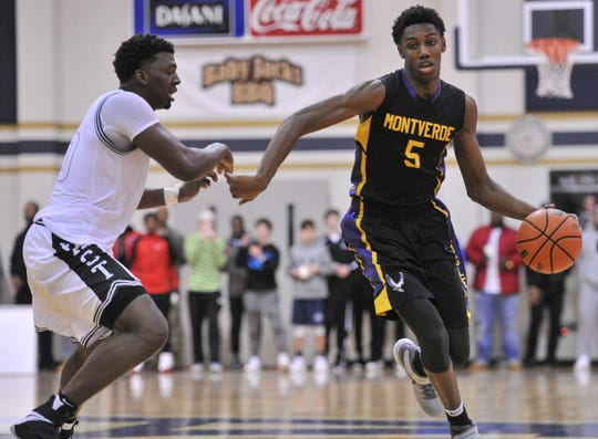 Jan 7, 2017; Arlington, TN, USA; Montverde Academy Eagles R.J. Barrett guard (5) goes to the basket against East Mustangs Radarious Washington forward (10) during the game at Arlington High School. Mandatory Credit: Justin Ford-USA TODAY Sports