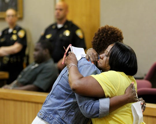 Jonelle Melton's sister Rachel Saddler-Haslon (left) and aunt Sandra Byrd hug as they read victim statements during the sentencing for Gregory Jean-Baptiste in State Superior Court in Freehold Thursday, May 30, 2019.   Jean-Baptiste was sentenced to a life prison term for the murder of the Red Bank School teacher Melton in her Neptune City home in 2009.