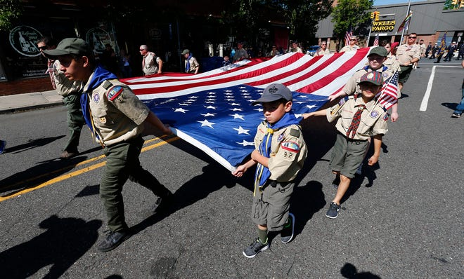 Scouts from Tropp and Park 92 in Toms River carry a large American flag along Washington Street in Toms RIver, NJ. Monday, May 27, 2019, during the town's annual Memorial Day parade.