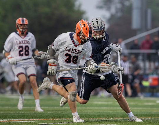 Matt Palazza, Mountain Lakes and Jack Fabean, Manasquan, battle for a loose ball during first half action. Manasquan Boys Lacrosse vs Mountain Lakes in NJSIAA Group 1 Boys Lacrosse State Final in West Long Branch, NJ.