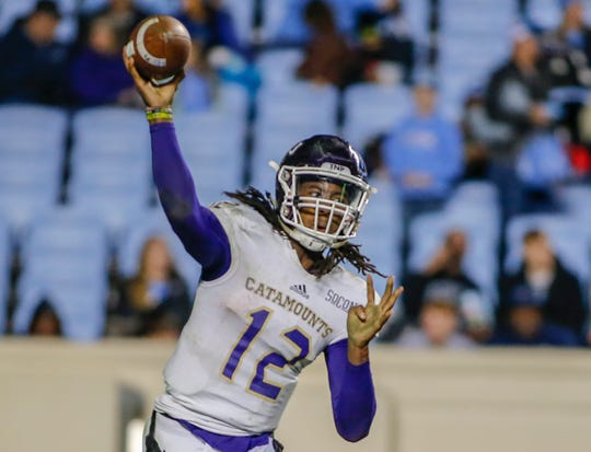 Tyrie Adams (12) passed for 322 yards with three touchdowns in Western Carolina's win at VMI