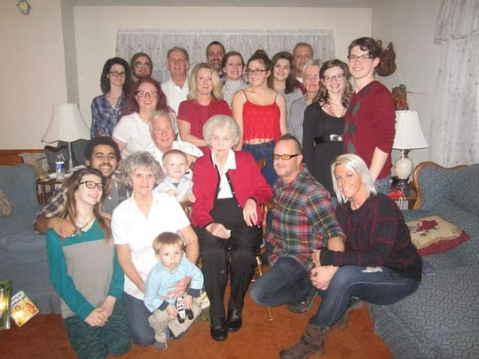 Evelyn Zlock, center, with her family at Christmas. Evelyn loved her family's Christmas Even traditions.