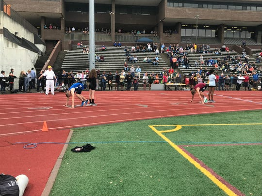 Lance Jensen of Candor, left, about to embark on a Section 4-championship 400 hurdles race.