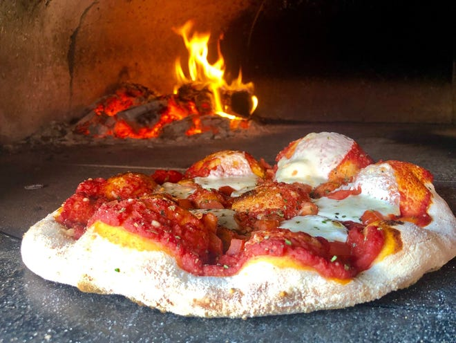 A Margarita Pizza in an FM Pizza wood-fired oven.