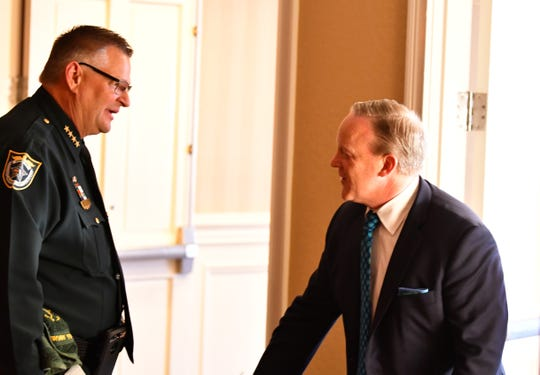 Brevard County Sheriff Wayne Ivey chats with former White House press secretary Sean Spicer before the dinner.
