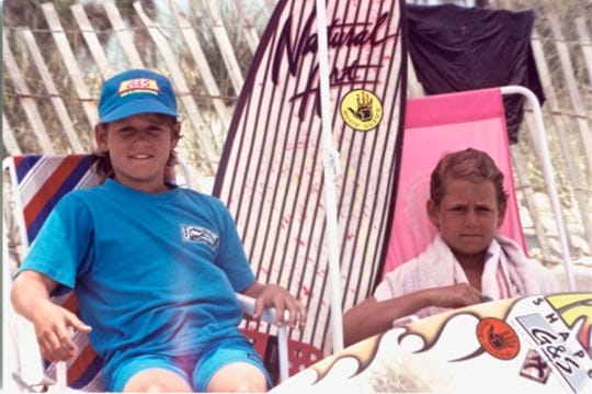 A much younger C.J. and Damien Hobgood, as seen on the beach.