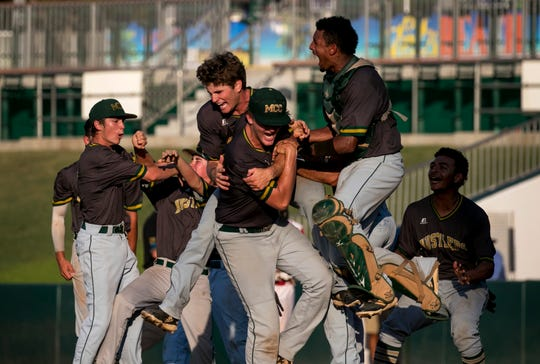 Melbourne Central Catholic celebrates their 6-3 win over Cardinal Gibbons in the class 5A state baseball finals on Thursday, May 30, 2019, in Fort Myers.
