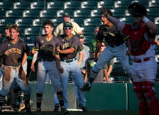 Melbourne Central Catholic players cheer as they score on a three-run double in the eighth inning against Cardinal Gibbons in the class 5A state baseball finals on Thursday, May 30, 2019, in Fort Myers.