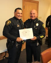 Senior Officer Heriberto Martinez poses for a photo with Chief Mike Markle.  Martinez received the department's Life Saving Award for getting a man out of a burning vehicle on Jan. 1, 2019.