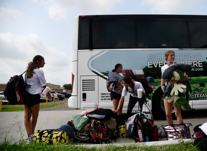 Members of the Calallen softball team prepare to load onto the bus heading to Austin for the UIL State tournament, Thursday, May 30, 2019, at Calallen High School.