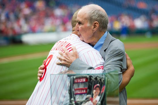 Aug 3, 2018; Philadelphia, PA, USA; Philadelphia Phillies chairman David Montgomery hugs former player Shane Victorino during his retirement ceremony before a game against the Miami Marlins Citizens Bank Park. Mandatory Credit: Bill Streicher-USA TODAY Sports