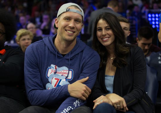 Former Eagles quarterback Nick Foles and his wife Tori Foles watch a Sixers-Celtics playoff game in May 2018 at the Wells Fargo Center in Philadelphia.  Foles, who is now a member of the Jacksonville Jaguars, shared personal news on social media after his wife suffered a miscarriage .