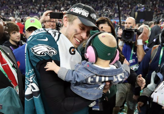 Nick Foles celebrates the Eagles' Super Bowl win with his daughter Lily and his wife Tori Foles.