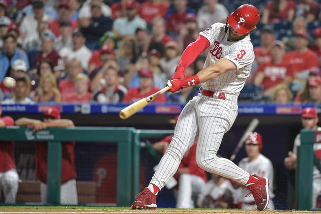 May 29, 2019; Philadelphia, PA, USA; Philadelphia Phillies right fielder Bryce Harper (3) hits a single in the first inning of the game against the St. Louis Cardinals at Citizens Bank Park. Mandatory Credit: John Geliebter-USA TODAY Sports
